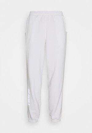 NINJA PANT UNISEX - Tracksuit bottoms - white
