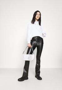 Topshop - CROC FLARE - Trousers - black - 1