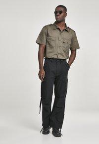 Brandit - VINTAGE - Cargo trousers - black - 1