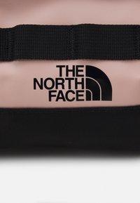 The North Face - TRAVEL CANISTER UNISEX - Wash bag - light pink/black - 4