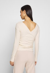Nly by Nelly - CRISS CROSS SHOULDER - Long sleeved top - beige - 2