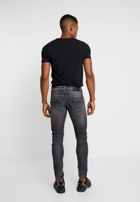 Tigha - BILLY THE KID - Slim fit jeans - mid grey - 2