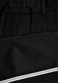 Name it - NKFLORNELIA IDA  - Kalhoty - black - 3