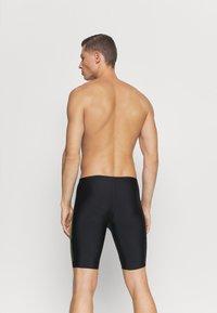 Speedo - TECH PLACEMENT JAMMER - Swimming trunks - black/fluo yellow - 1