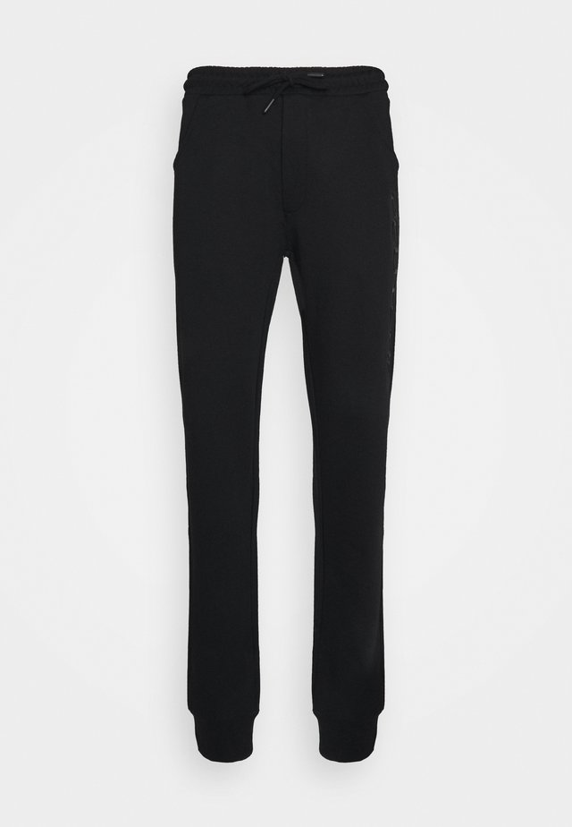 DISCUS - Pantalon de survêtement - black