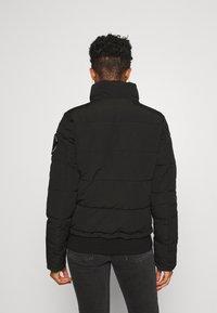 Superdry - EVEREST - Winter jacket - black - 4
