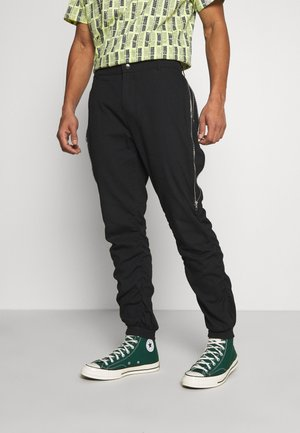 GATHERS PANTS - Cargo trousers - black