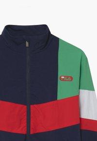 Fila - CHRIS WIND - Training jacket - black iris/true red/ginko green/bright white - 2