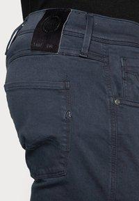 Replay - ANBASS HYPERFLEX - Slim fit jeans - blue - 4
