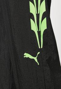 Puma - EVIDE TRACK PANT - Tracksuit bottoms - black - 5
