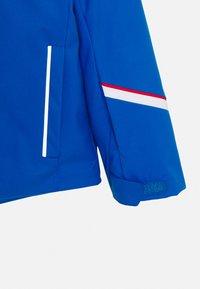 Kjus - BOYS FORMULA JACKET - Lyžařská bunda - aruba blue - 3