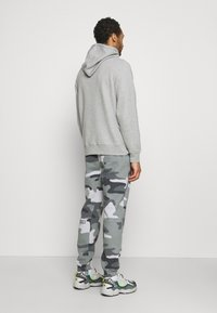 Hollister Co. - Tracksuit bottoms - green camo - 2