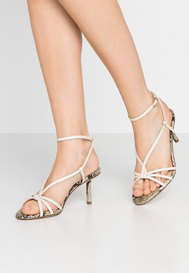 PIPPA - Sandaalit nilkkaremmillä - modern ivory