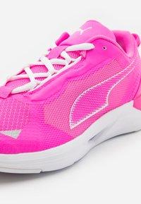 Puma - MINIMA  - Neutral running shoes - luminous pink/white - 5
