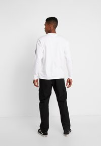 Urban Classics - RIPSTOP CARGO PANTS - Cargo trousers - black - 2