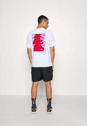 SUNRIDDIM  UNISEX - Print T-shirt - white
