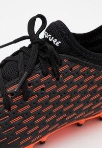 Puma - FUTURE 6.4 MG JR UNISEX - Moulded stud football boots - black/white/shocking orange - 5