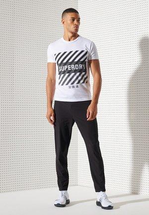 TRAINING CORESPORT GRAPHIC - Print T-shirt - optic