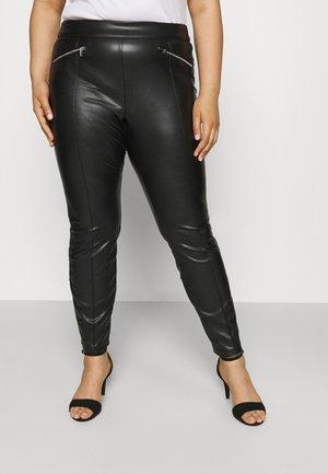VIKISS COATED - Trousers - black