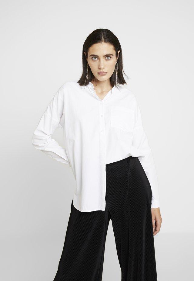 TIKKI - Button-down blouse - white