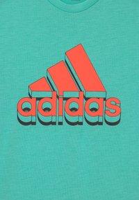 adidas Performance - UNISEX - Camiseta estampada - turquoise/orange - 2