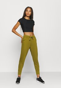Nike Performance - DRY GET FIT  - Tracksuit bottoms - olive flak - 1