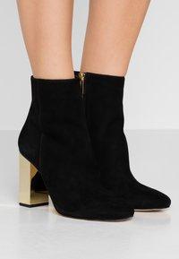 MICHAEL Michael Kors - PETRA - High heeled ankle boots - black - 0