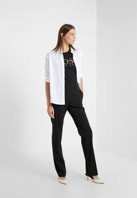 BOSS - TIBOSS - Print T-shirt - black - 1