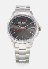 silver-coloured/grey