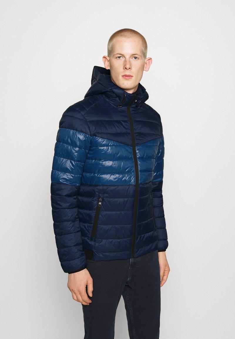 Calvin Klein - HOODED JACKET - Light jacket - blue