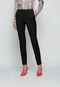 BOSS - TAXTINY - Trousers - black - 0