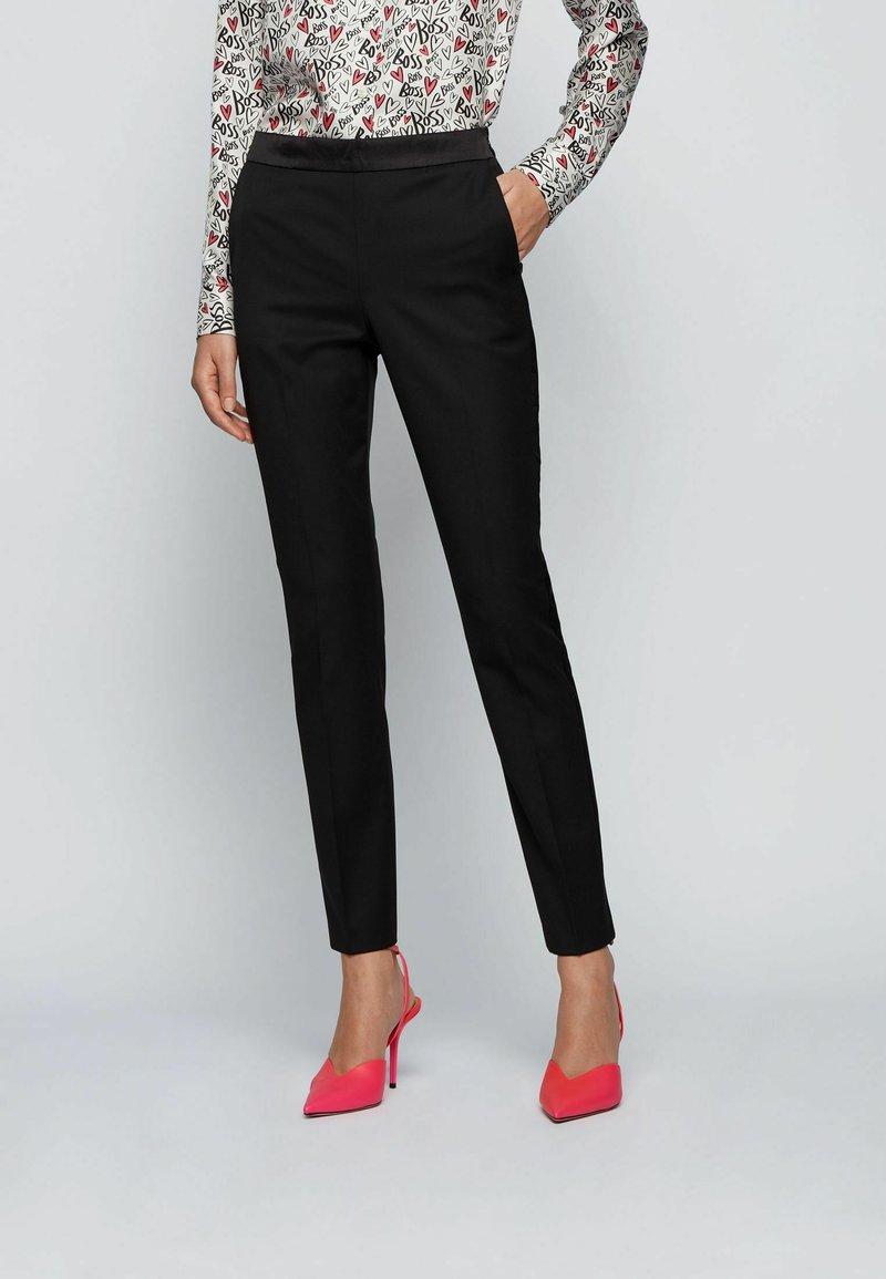 BOSS - TAXTINY - Trousers - black