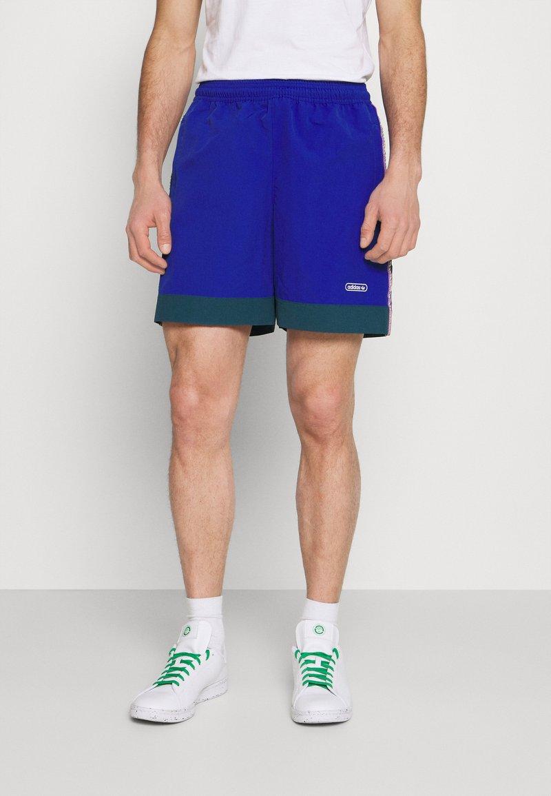 adidas Originals - TAPED UNISEX - Shorts - team royal blue