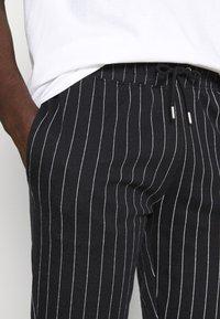 Topman - STRIPE JOG - Tracksuit bottoms - black - 4