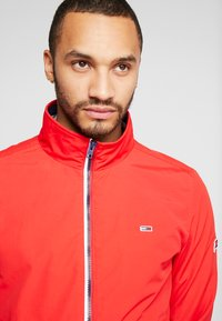 Tommy Jeans - ESSENTIAL JACKET - Summer jacket - racing red - 3