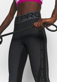 Nike Performance - Leggings - black/white/metallic silver - 4