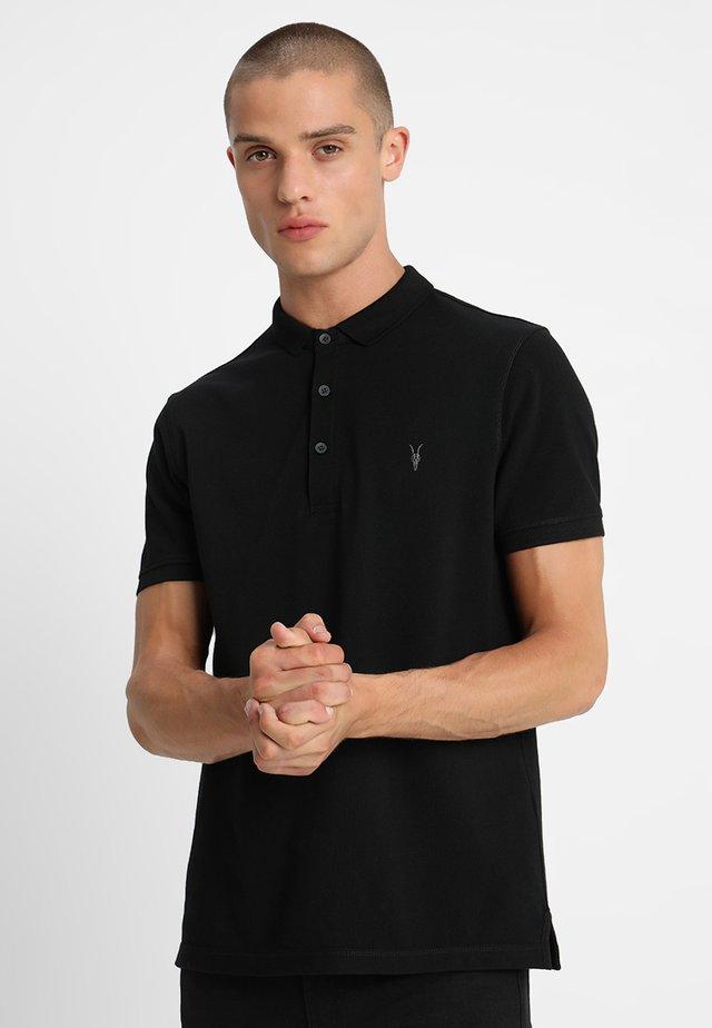 REFORM - Poloshirts - black