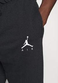 Jordan - Pantalon de survêtement - black/white