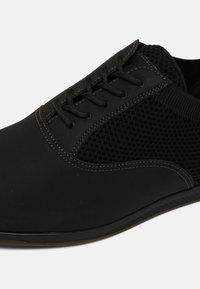 ALDO - BALLAN - Casual lace-ups - black - 5