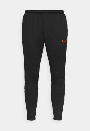 ACADEMY PANT - Pantalon de survêtement - black/bright crimson