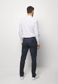 Selected Homme - SLHSLIM-AIDEN - Trousers - navy blue - 2