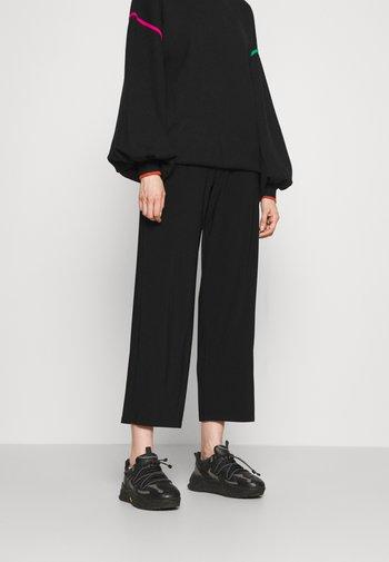SIBILLA - Trousers - black