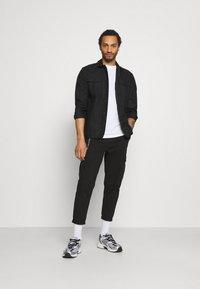 Redefined Rebel - HARVEY PANTS - Cargo trousers - black - 1