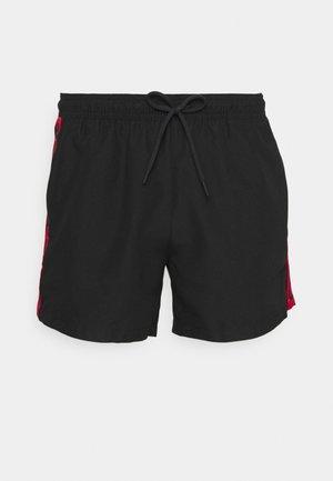 DOKU - Swimming shorts - black