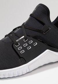Nike Performance - FREE METCON 2 - Minimalist running shoes - black/white - 5