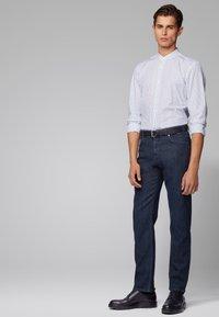 BOSS - ALBANY - Straight leg jeans - dark blue - 1