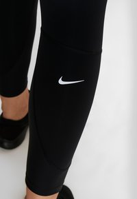 Nike Performance - EPIC LUX - Legginsy - black/reflective silver - 8