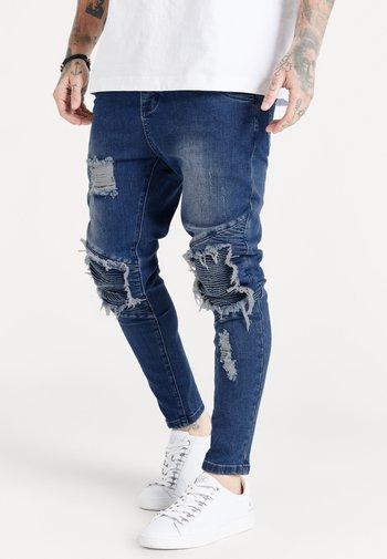 RAW HEM BIKER - Skinny-Farkut - midstone blue