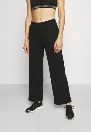 HER WIDE PANTS - Teplákové kalhoty - black
