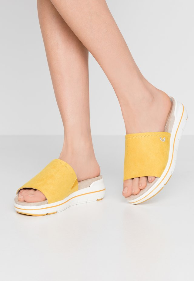 Matalakantaiset pistokkaat - yellow